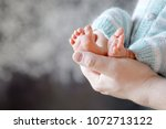 baby feet in father hands. tiny ... | Shutterstock . vector #1072713122
