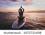 yoga on sup  silhouette of man... | Shutterstock . vector #1072721438