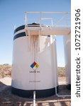 a crue oil storage tank located ... | Shutterstock . vector #1072721906