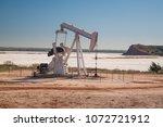 an oil well pumping station... | Shutterstock . vector #1072721912