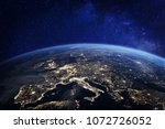 Europe at night viewed from space with city lights showing human activity in Germany, France, Spain, Italy and other countries, 3d rendering of planet Earth, elements from NASA