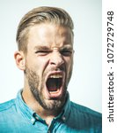 man with angry screaming face.... | Shutterstock . vector #1072729748