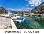 a small bay with boats. kotor.... | Shutterstock . vector #107275406