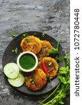 alu ki tikki   indian snack...   Shutterstock . vector #1072780448