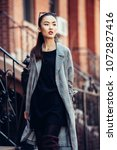 beautiful asian girl walking on ... | Shutterstock . vector #1072827416