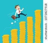 businessman climbing up a money ... | Shutterstock .eps vector #1072827518