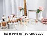 perfume bottles on dressing... | Shutterstock . vector #1072891328