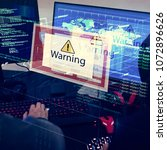 Small photo of Computer with warning pop up sign window