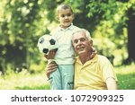 happy grandfather and child... | Shutterstock . vector #1072909325