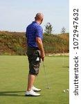 man playing golf | Shutterstock . vector #1072947632