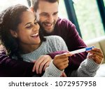 happy couple with pregnancy news | Shutterstock . vector #1072957958
