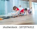 happy sporty children in gym.... | Shutterstock . vector #1072976312