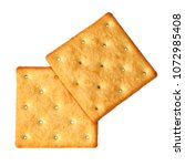 crackers isolated on white... | Shutterstock . vector #1072985408