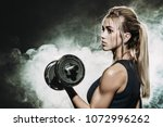 muscular young woman with... | Shutterstock . vector #1072996262
