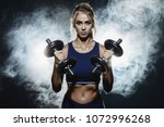 muscular young woman with... | Shutterstock . vector #1072996268