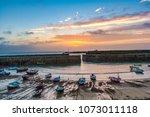 sunrise over mousehole harbour  ... | Shutterstock . vector #1073011118