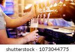 focused professional bartender... | Shutterstock . vector #1073044775
