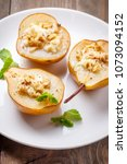 pears baked with ricotta cheese ... | Shutterstock . vector #1073094152