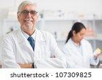pharmacist looking at camera... | Shutterstock . vector #107309825