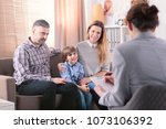 smiling son with his happy... | Shutterstock . vector #1073106392