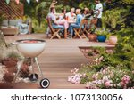 grill with sausages in the... | Shutterstock . vector #1073130056