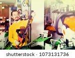 smiling adult guy deciding on... | Shutterstock . vector #1073131736