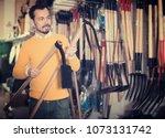 positive guy deciding on best... | Shutterstock . vector #1073131742