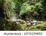 valley between mossy rocks... | Shutterstock . vector #1073159855