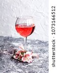 Small photo of glass of sangria with flowers