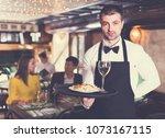 portrait of frendly male waiter ... | Shutterstock . vector #1073167115