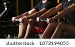 athletes doing rowing practice | Shutterstock . vector #1073194055