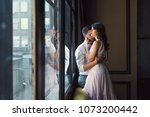 young couple hugging by the... | Shutterstock . vector #1073200442