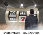 back of man looking at casino... | Shutterstock . vector #1073207906