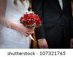 red roses in brides hands | Shutterstock . vector #107321765