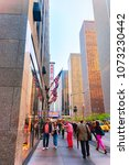 Small photo of New York, USA - May 06, 2015: People walking by Radio City Music Hall at 6th Avenue in New York. Radio City exists since 1932 and is registered in U.S. National Register of Historic Places