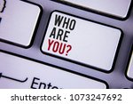 Small photo of Writing note showing Who Are You Question. Business photo showcasing Introduce or Identify Yourself Tell your Personal Story written on white keyboard key with copy space. Top view.