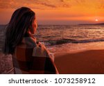 young woman standing on sand... | Shutterstock . vector #1073258912