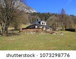 nice little house in alpine... | Shutterstock . vector #1073298776