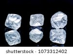 raw diamonds isolated on black... | Shutterstock . vector #1073312402