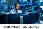 in the system monitoring room... | Shutterstock . vector #1073337968