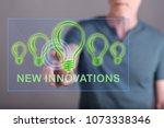 man touching a new innovations... | Shutterstock . vector #1073338346