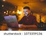 a young handsome caucasian man... | Shutterstock . vector #1073359136