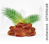 date fruits with palm leaves... | Shutterstock .eps vector #1073456168