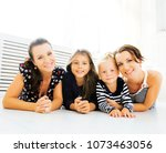 mature sisters twins at home... | Shutterstock . vector #1073463056