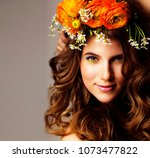 beauty young woman with flowers ... | Shutterstock . vector #1073477822