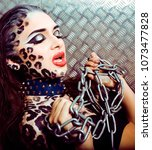 young sexy woman with leopard... | Shutterstock . vector #1073477828