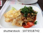 fried egg and vegetables with...   Shutterstock . vector #1073518742