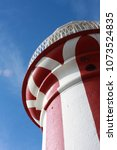 stripe light house on a sunny... | Shutterstock . vector #1073524835