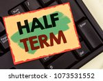 Small photo of Writing note showing Half Term. Business photo showcasing Short holiday in the middle of the periods school year is divided. Concept For Information