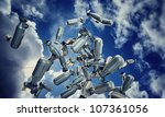 bombs falling from blue sky - stock photo